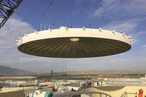 Massive Roof of a Circular Structure Hoisted in the Air by a Crane